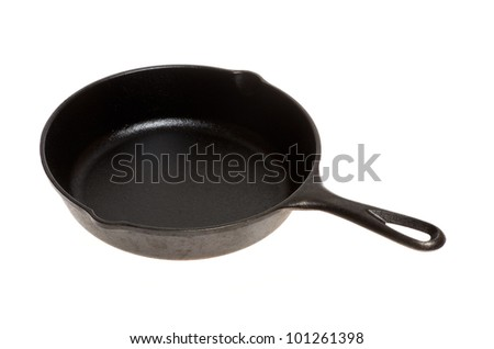 A vintage cast iron skillet or frying pan on white