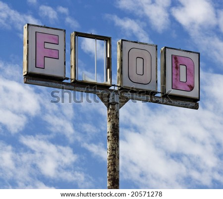A vintage food sign with one of the letters broken out