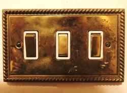 A vintage gold light switch