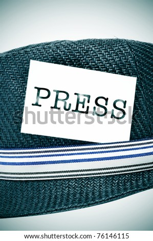 a vintage hat with a label with the word press