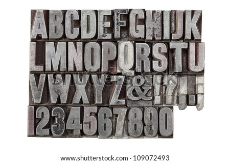 A vintage letterpress alphabet isolated on a white background