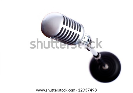 A vintage looking microphone on a white background with copy space