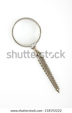 A vintage magnifying glass on white background.