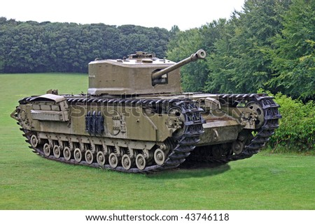 A Vintage Military Tank on a Grass Field.