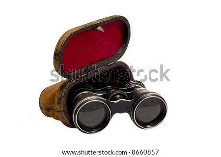A vintage opera glasses with leather case.