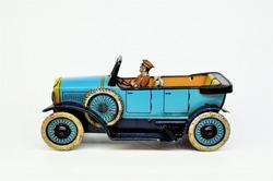 A vintage Oro litho printed tinplate toy open car on plain white.