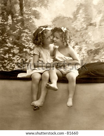 stock photo : A vintage photograph (c. 1900) of two little girls cheek