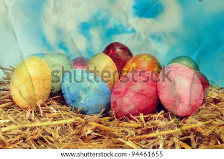 a vintage picture of some easter eggs on a nest