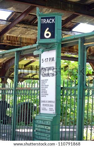 A vintage platform sign at an old railroad station