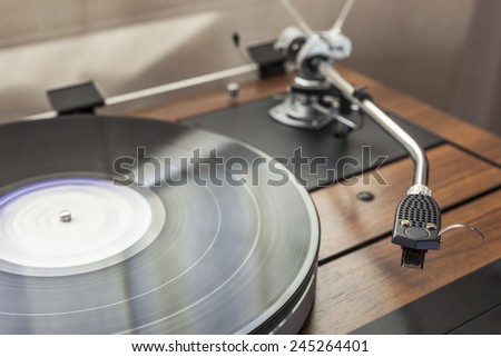 A vintage record player(turntable) with LP(record) #245264401