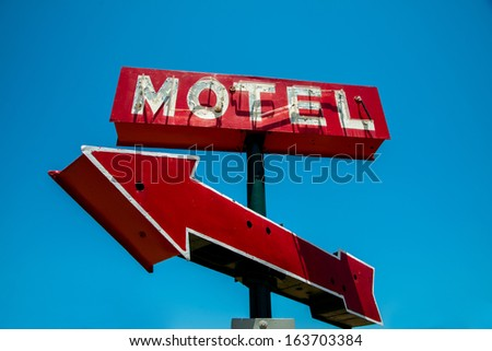a vintage red neon hotel sign...
