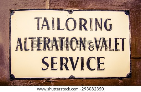 a vintage sign for a tailor and ...
