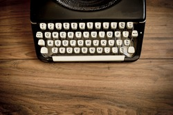 A Vintage Typewriter on a wooden table.