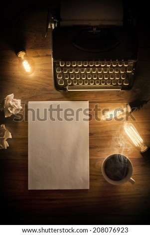A Vintage Typewriter on a wooden table with lightbulbs and writing paper.