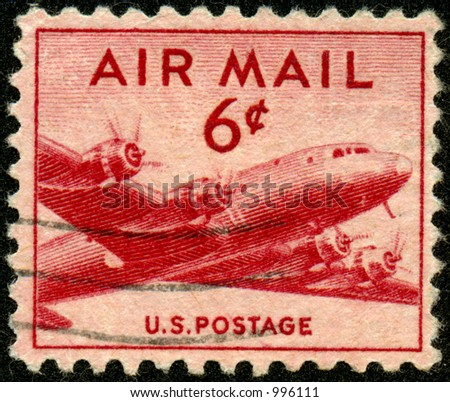 A vintage US Airmail Stamp with airplane. Six Cents.