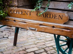 A vintage wheel barrow in London's Covent garden. Old market area, now for shopping, restaurants, shops and tourism sightseeing.