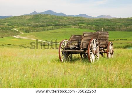 a vintage wood wagon on prairie ...