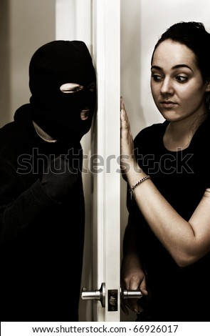 A Violent Intruder Bashes On A Door While A Female Occupant Hesitantly Opens Up