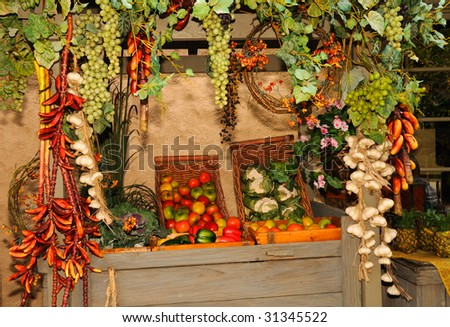 A vivid display of various fruits and vegetables in a wooden cart at the marketplace.