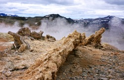 A volcanic bridge surrounded by sulfuric clouds