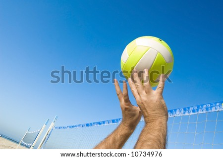 volleyball player spiking ball. stock photo : A volleyball