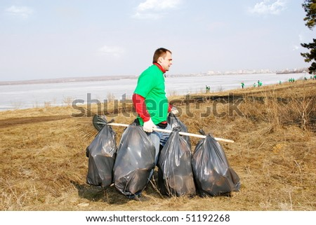 A volunteer removes debris - stock photo