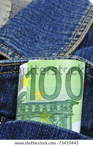 a wad of 100 euro bills in the pocket of jeans