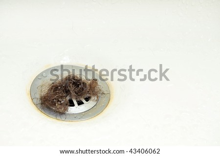 A wad of hair on a shower drain pipe.