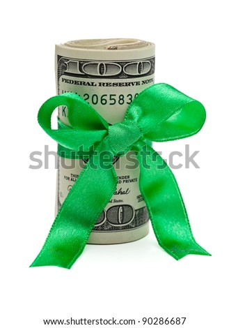A wad of US one hundred dollar bills wrapped in a green ribbon with a gift bow attached.