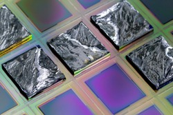 A wafer is a thin slice of semiconductor material, such as a crystalline silicon, used in electronics for the fabrication of integrated circuits.Selective focus on pieces.
