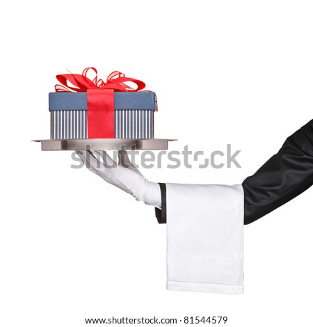 A waiter holding a silver tray with a gift on it isolated on white background