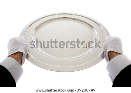 A waiter with white gloves  holding a sterling silver tray on a white background