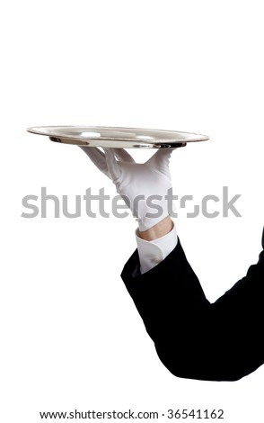 A waiters arm with a glove on the hand holding a silver serving tray with copy space