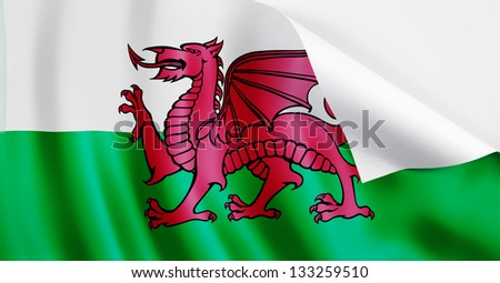 A Wales flag with a curl at the corner with blank space for text.