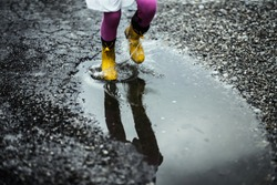 A walk in yellow rubber boots through puddles and mud.