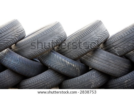 A wall build from old used car tyres. Isolated on white with copyspace.