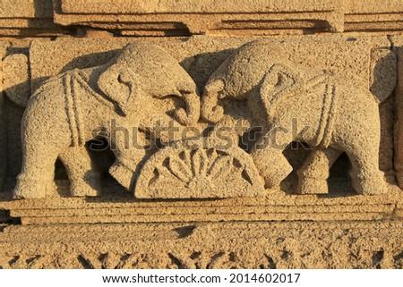 A Wall carving of two elephants graciously riding over semi-circular block of lotus at Rukmini Temple on seashore at Dwaraka, Gujarat, India, Asia Stock fotó ©