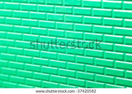 A wall formed by metal bricks