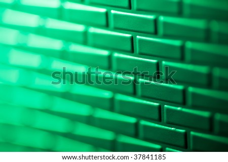 A wall formed by metal bricks - stock photo