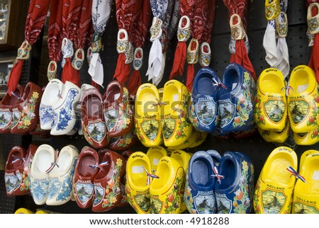 a wall full of painted wooden shoes from Holland
