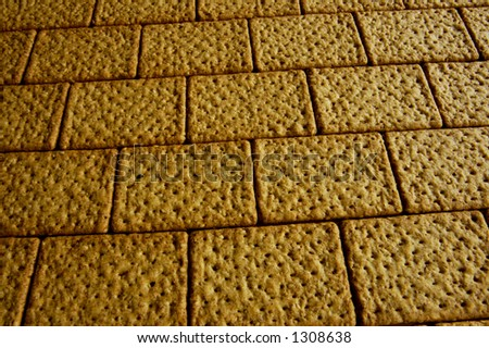 A wall made of wholemeal bicuits, close up. - stock photo