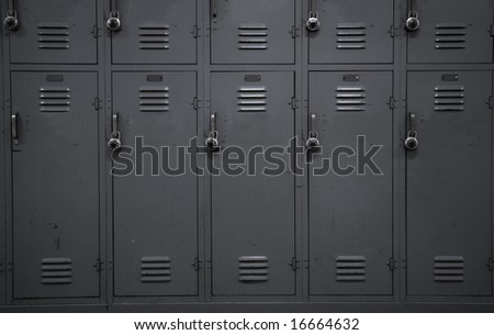 A wall of gray school lockers typical of an American public high-school