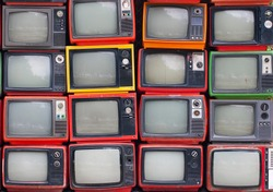 A wall of old vintage tube televisions