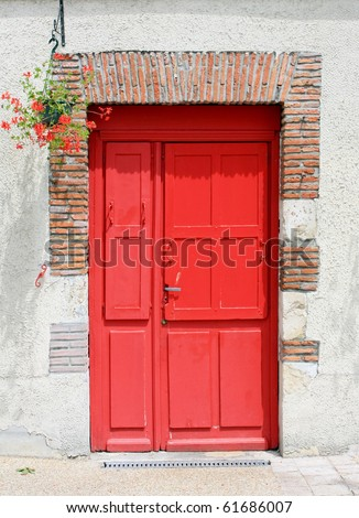 A wall with a red door