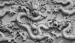 A wall with dragon stone sculpture in fayu temple in mount putuo zhoushan city zhejiang province China.