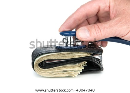 A wallet full of cash being examined for life in a poor economy and recession.  Can be used for medical cost inferences or economic conditions.