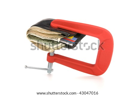 A wallet full of cash being squeeze during tough economic times.  Good image for financial inferences such as budgeting and spending control.