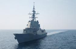 A war frigate ship sailing at sea in summer.