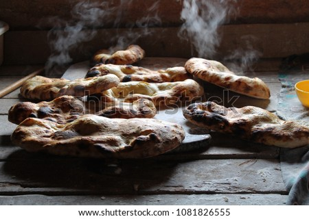 A warm and steamy Turkish Ramadan bread. / Duman? üzerinde ramazan pidesi. #1081826555