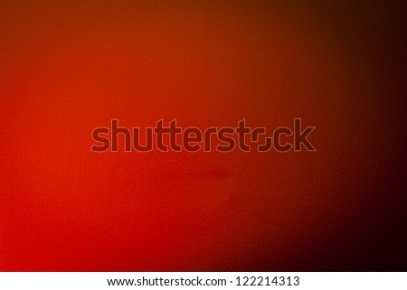 A warm light falls off of a wall creating a nice gradient